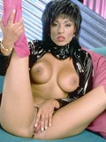 Isis Nile in black latex spreading pussy from Pornstar Legends